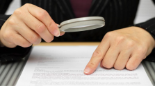 checking-a-contract-with-magnifying-glass